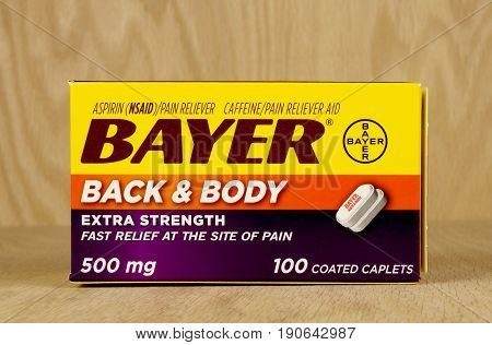RIVER FALLS,WISCONSIN-JUNE 10,2017: A box of Bayer brand back and body pain relief caplets with a wood background.