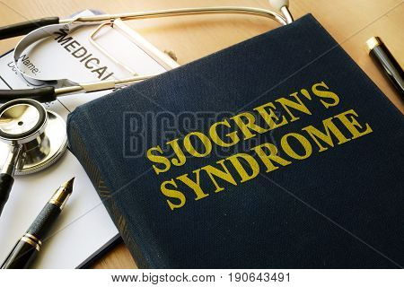 Book with title Sjogren's Syndrome on a table.