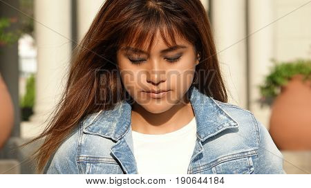 A Bashful Girl With Long Brunette Hair