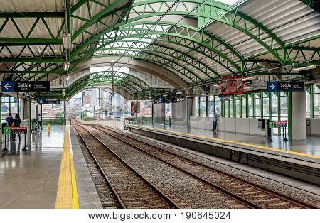 Medellin, Colombia- March 5, 2017:Medellin Metro Station with railway and people Colombia