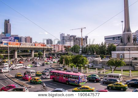 BANGKOK, THAILAND - JUNE 3, 2017 : Victory Monument is remarkable soldier statue for respect bravery in war Center of Bangkok city, With traffic around.