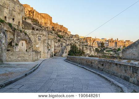 beautiful ancient ghost town of Matera (Sassi di Matera) in beautiful red reflection on building in sunrise south Italy.