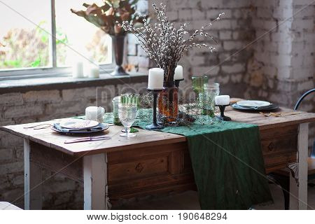Rustic dinning table with chairs and vintage wine glass
