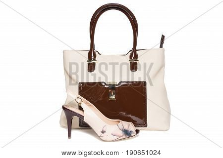 Bag and shoes of beige color on a white background