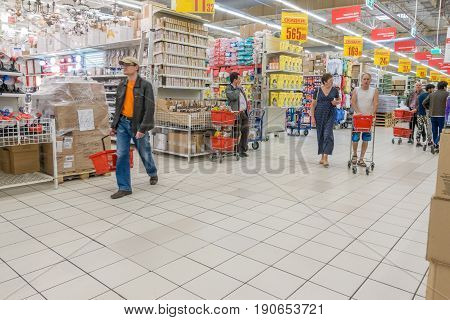 RUSSIA, MOSCOW, JUNE 11, 2017: People Shopping for diverse products in Auchan supermarket, Moscow