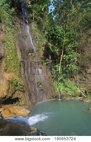 Waterfalls and turquoise green pool surrounded by lush tropical vegetation at La Conchuda waterfall in Rio la Venta Canyon Chiapas Mexico