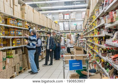RUSSIA, MOSCOW, JUNE 11, 2017: People Shopping for diverse products in Auchan supermarket.