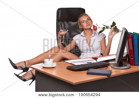 Businesswoman with glass of martini and red rose sits on armchair on a white background.