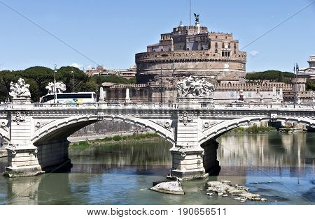 Rome, Italy - April 17, 2017: View on famous Saint Angel castle and bridge over the Tiber river in Rome, Italy