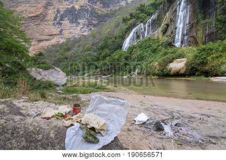 RIO LA VENTA CANYON CHIAPAS MEXICO - MAY 1 2017: Trash left behind from hikers degrades the pristine natural beauty of La Conchuda waterfall in Chiapas Mexico