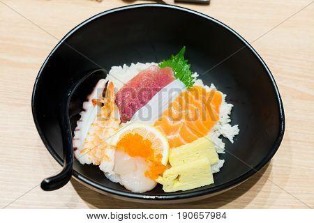 Chirashi Sushi Bowl With Salmon Tuna Shrimp Served With Wasabi
