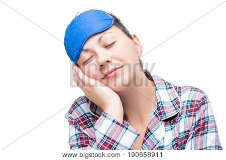 Girl In Pajamas Fell Asleep In A Sitting Position, Portrait On A White Background