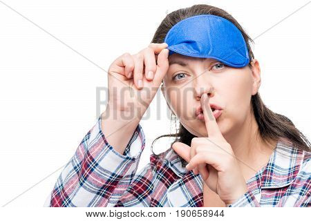 Woman In Pajamas Shows Gesture Behave Silently On White Background