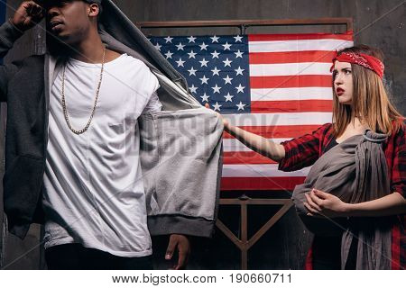 Baby without father. Family relationship problem. Sad wife and husband on USA national flag background. Divorce, social problem, father leaving, youth pregnancy concept