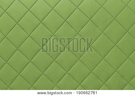 detail of sewn leather green leather upholstery background pattern
