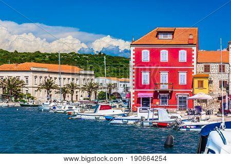 Seafront view at colorful touristic destination - Island Hvar, Croatia summertime.