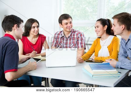 Group of young students studying together.