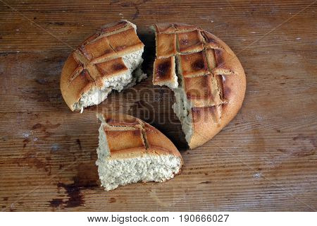 ZAGREB, CROATIA - SEPTEMBER 21: Breaking of a fresh loaf of Eucharistic bread in Zagreb, Croatia on September 21, 2016.