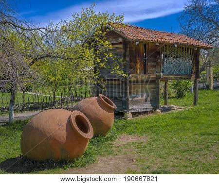 Old ceramic vessels for making wine are dug in the ground in the Georgian village