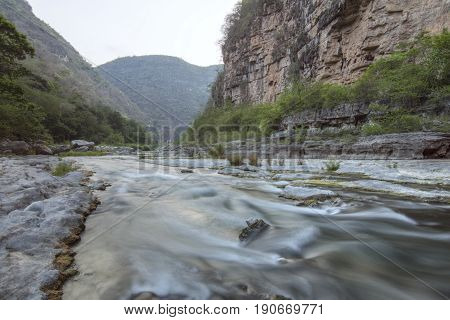 Slow shutter river rapids and dim light in rugged mountain canyon of Rio la Venta in Chiapas Mexico