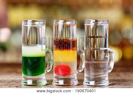 Multi-colored cocktails in a nightclub alcoholic multi-layered cocktails