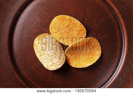 potato chips in an earthenware dish beer snack unhealthy eating