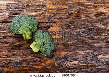 Inflorescence of raw broccoli on a wooden table With space for text horizontal shot