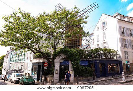 PARIS , France- June 01, 2017: View of typical paris cafe in Paris. Montmartre area is among most popular destinations in Paris, Le Moulin de la galette is a typical cafe.