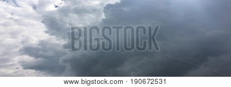 White clouds disappear in the hot sun on blue sky. Motion white clouds blue sky background.