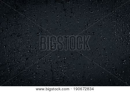 Water Drops On Dark Stone