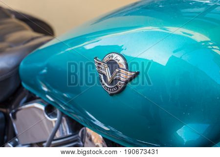 Samara Russia - May 19 2016: The emblem on the fuel tank of a motorcycle Kawasaki close-up