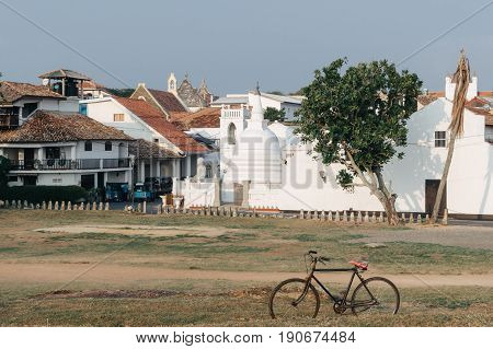 GALLE SRI LANKA - MARCH 22- 2017: Beautiful scenery of ancient Dutch Galle Fort (UNESCO World Heritage Site) with Christian church and Buddhist stupa - view from fortification wall southwest coast of Sri Lanka island South Asia