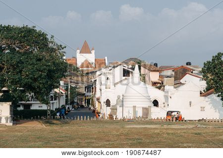 GALLE SRI LANKA - MARCH 22 - 2017: Beautiful scenery of ancient Dutch Galle Fort (UNESCO World Heritage Site) with Christian church and Buddhist stupa - view from fortification wall southwest coast of Sri Lanka island South Asia