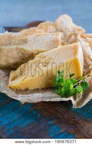 Traditional Italian hard cheese Parmesan and Grana Padano with grater and fresh basil on wrapper