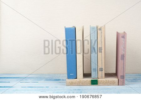 Book stacking, hardback books on wooden table. Back to school. Copy space for text.