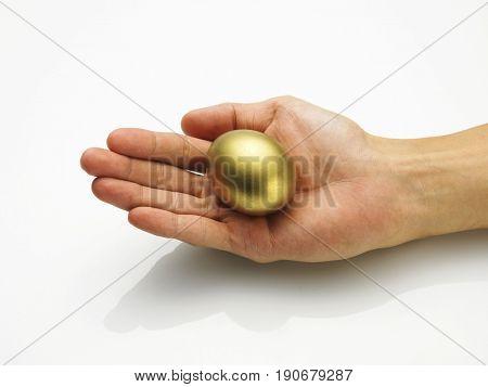 Palm holding a golden egg
