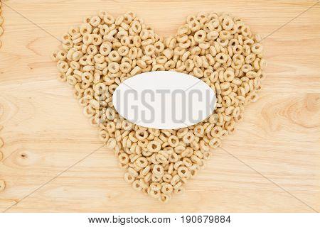 Cereal is a healthy snack Healthy oats cereal in the shape of a heart on wood with blank card for your message