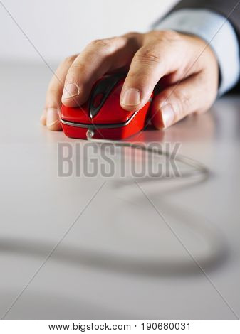 Front view of a hand moving a computer mouse