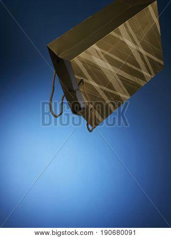Coloured paper bag being flip over