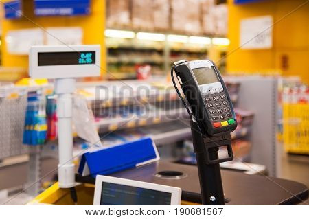 Cash Desk With Payment Terminal In Supermarket