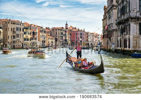 Venice Italy - May 19 2017: Gondola and motor boats are sailing along the Grand Canal. This is the main city transport in Venice.