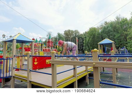 Nizhny Novgorod, Russia. - August 03.2016. Children playground game complex in Park Switzerland. The girl develops dexterity.