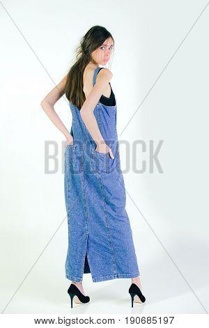 Woman With Long Brunette Hair In Long Jeans Denim Dress