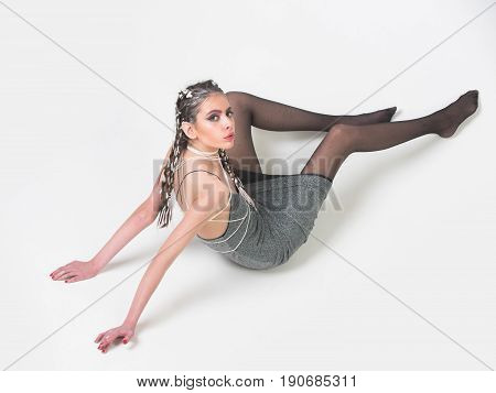 Pretty Woman Sitting In Grey Dress And Black, Nylon Pantyhose
