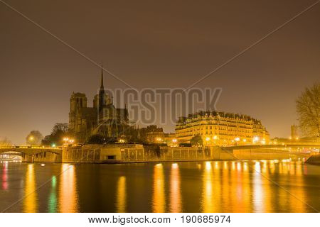 Notre Dame Cathedral with Paris cityscape at dusk, France