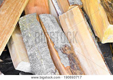 Sloppy Stacked Firewood From Alder Wood Backgrownd