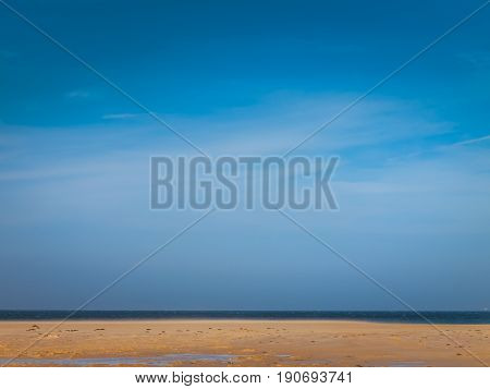 Beach background with blue sky and sand