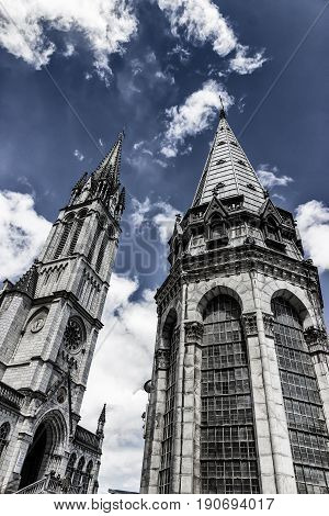 Sanctuary of Our Lady of Lourdes against the sky. Fragment. France