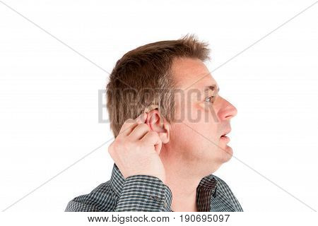 Middle-aged deaf man testing a hearing aid