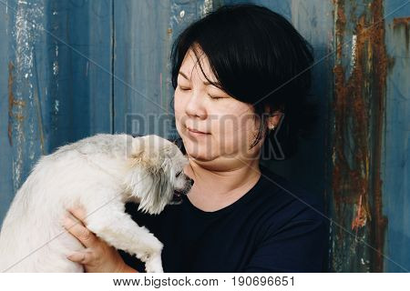 Asia Women And Dog Happy Hugging With Container